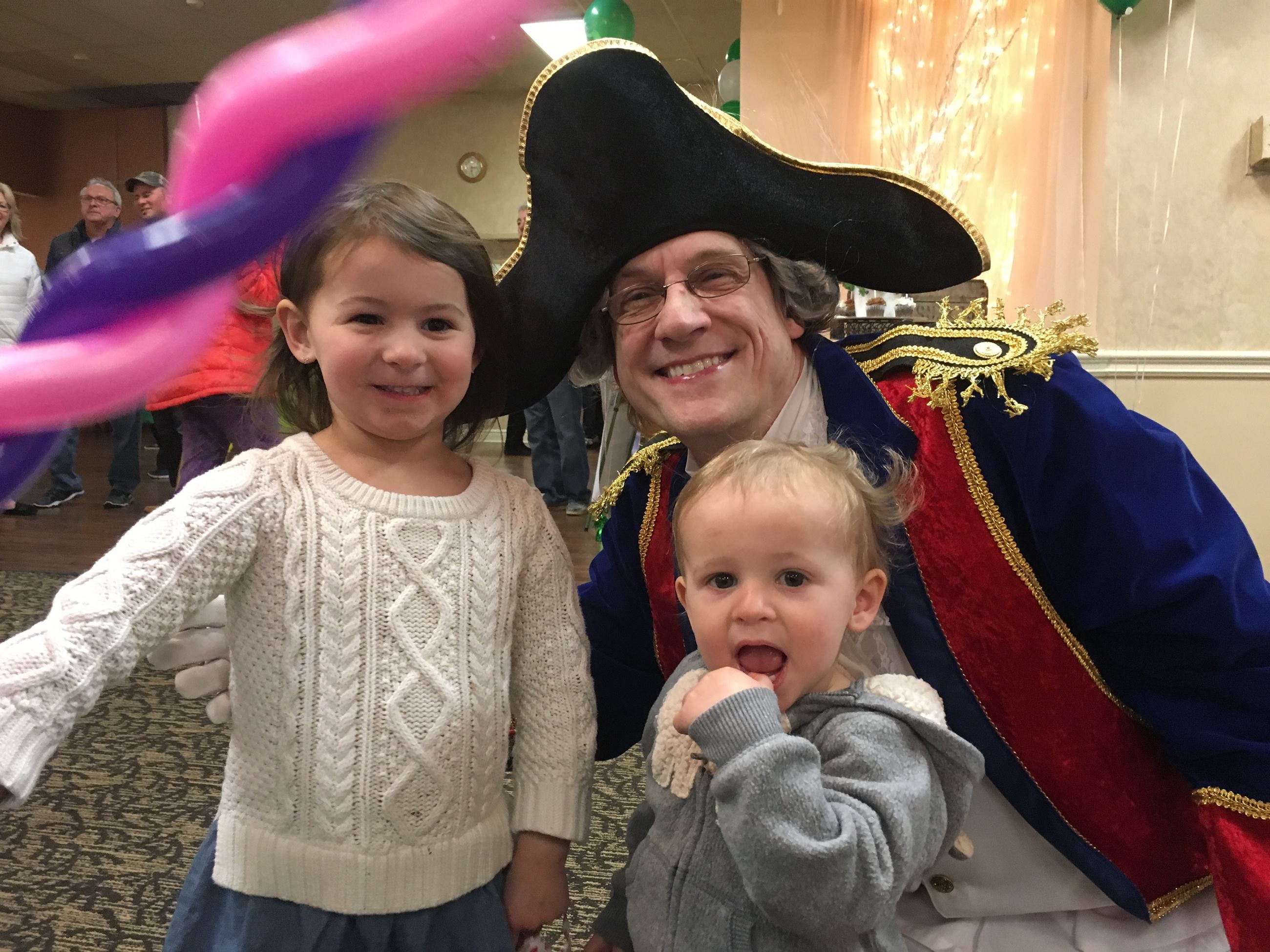 Man in Marquis de Lafayette costume with two little girls
