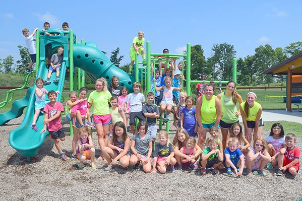 Children and counselors on playground at Summer Playground Camp
