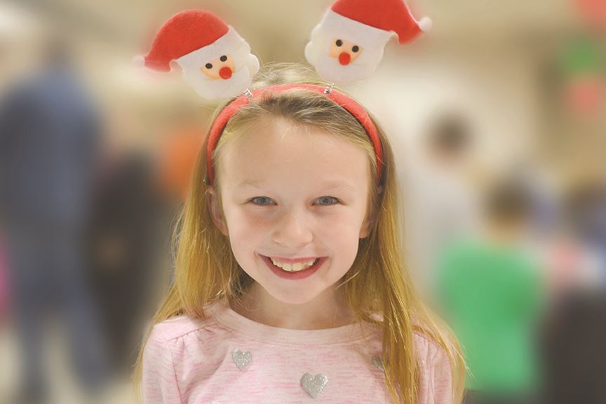 Girl wearing Santa headband