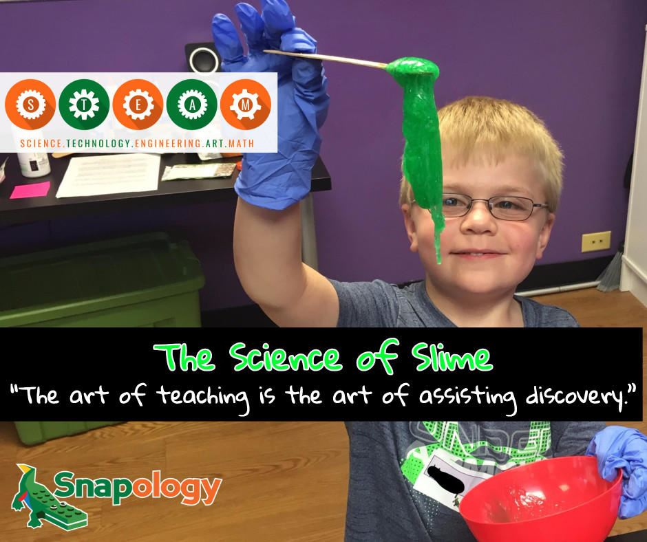 Child stretching a piece of slime