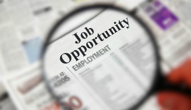 Job Opportunity text on newspaper image