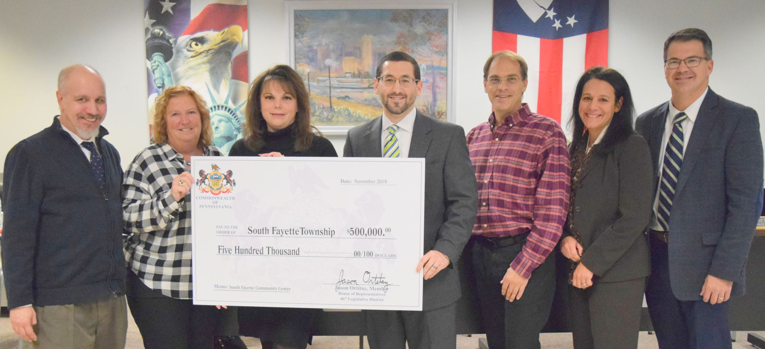 Township Commissioners pose with ceremonial check