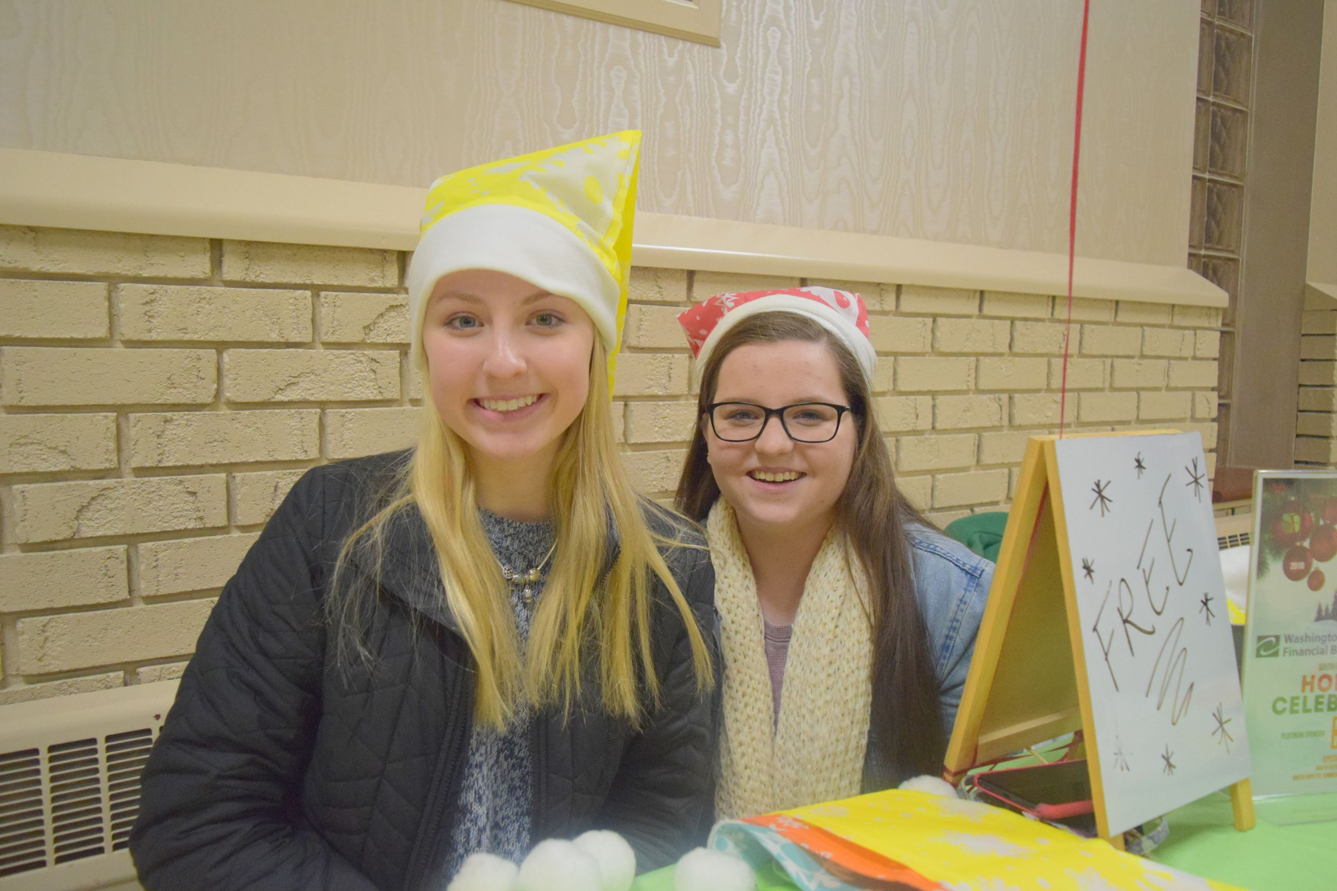 Two volunteers at the Holiday Celebration