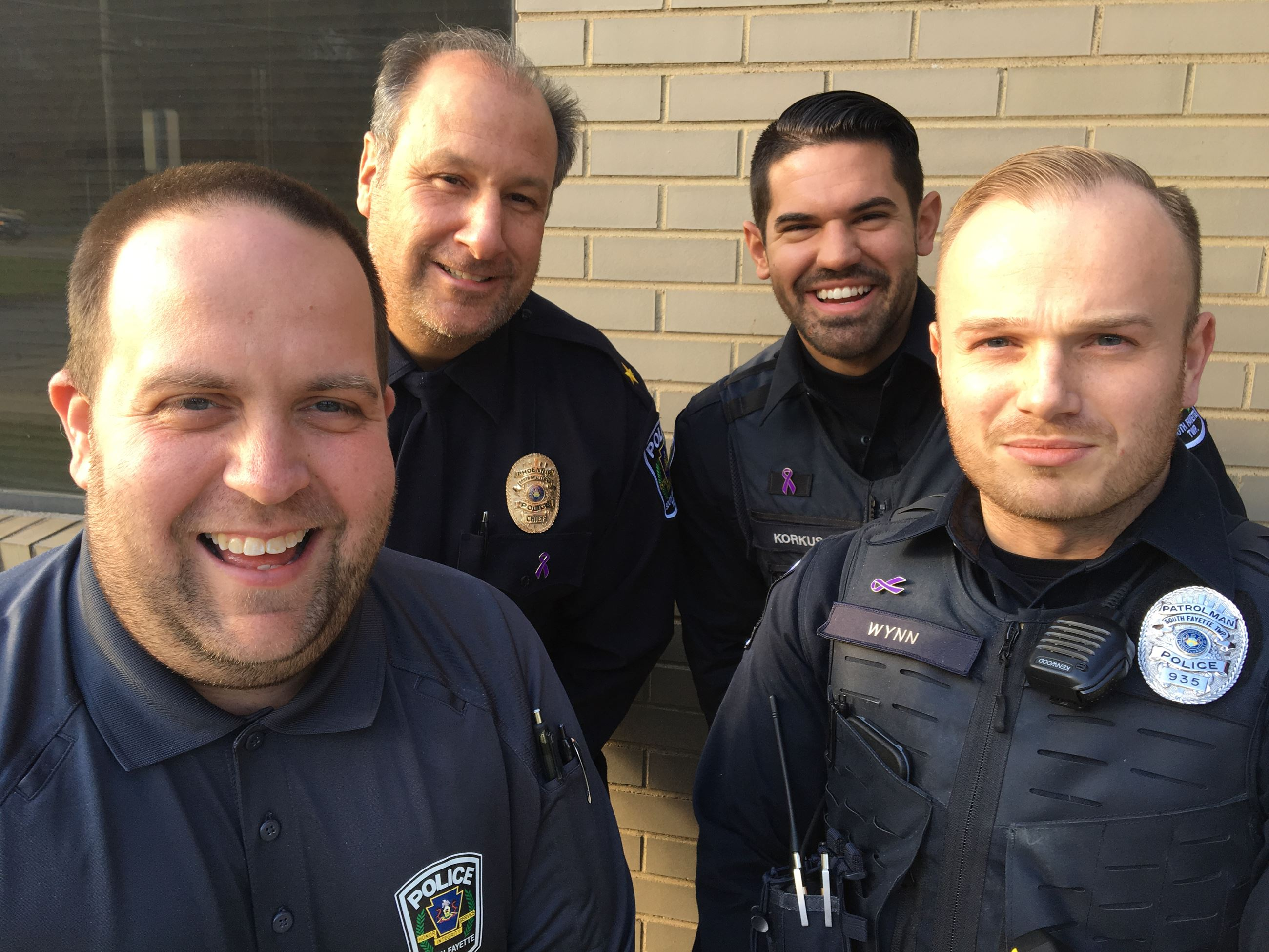 Four police officers growing beards