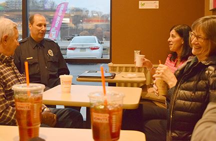 Police chief chats with residents over coffee