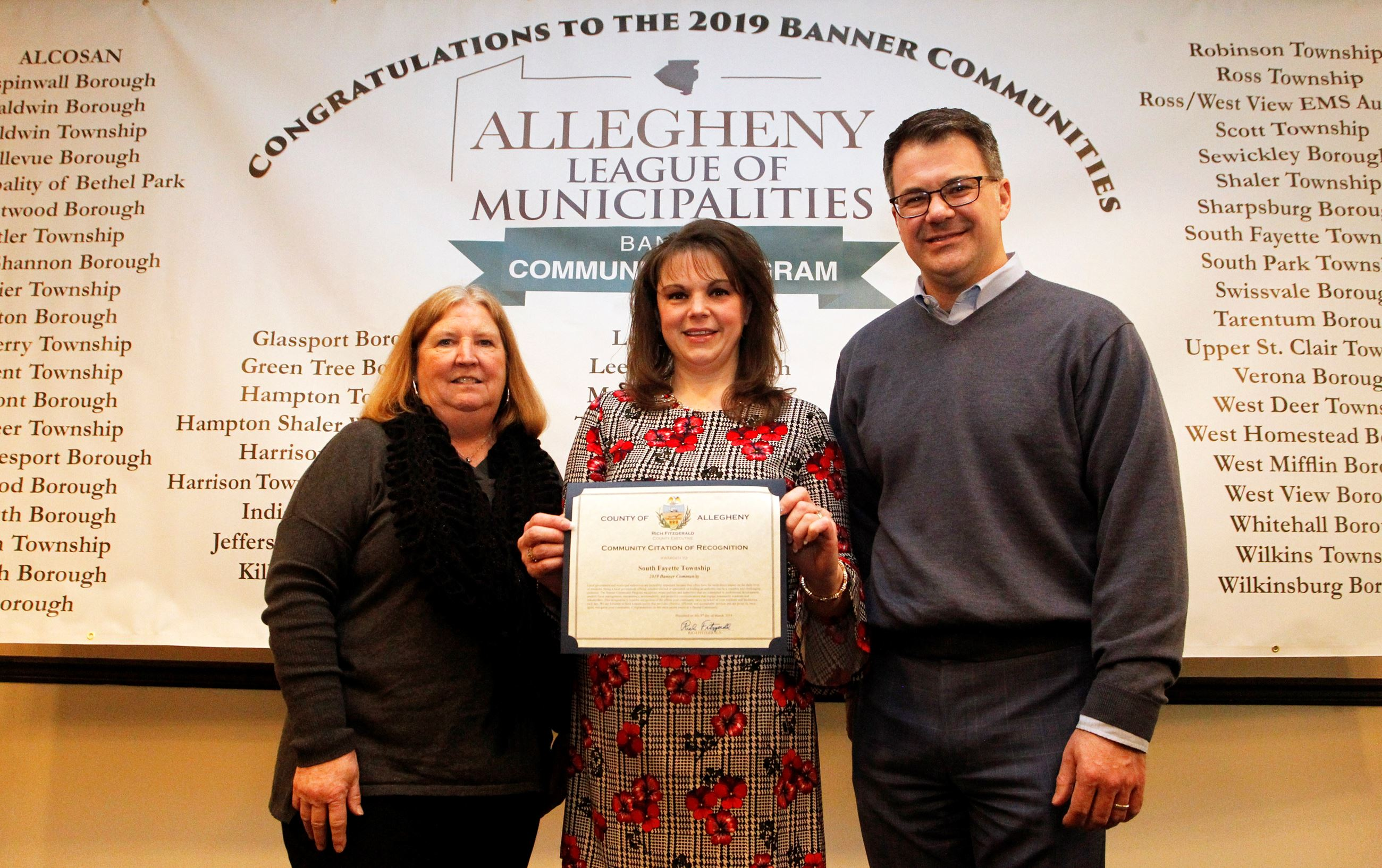 Three township representatives accept the 2019 Banner Community award