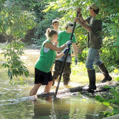 Volunteers work on creek project